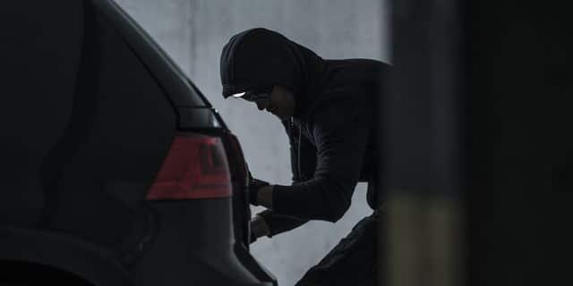 Burglar Jacking Car